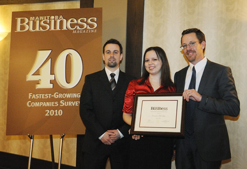 Justin Nedecky, Lyndsay Walker and John McDonald accept the award for the seventh fastest growing company in Manitoba.